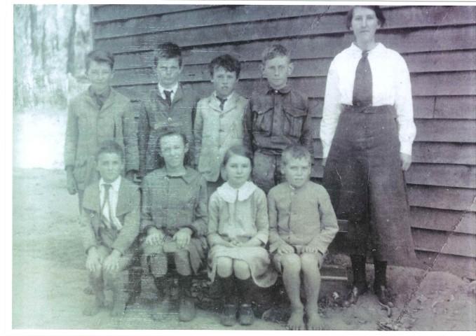School photo with teacher long ago.